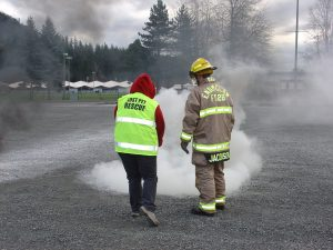 CERT MAR Volunteer Theresa Klein Extinguishes a Fire