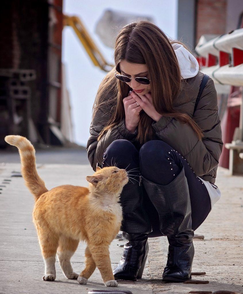 Woman Talking to Cat
